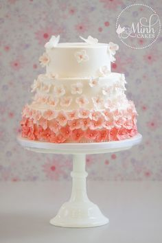 Hydrangeas in bloom - A new display cake for the upcoming wedding season. Soft pink hydrangeas in ombre tones and two curious butterflies on top.