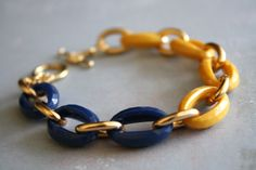 Arm Candy  mustard yellow navy blue and gold link by DailyDose, $14.00
