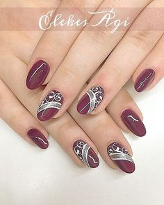 Burgundy with white & sliver nails.