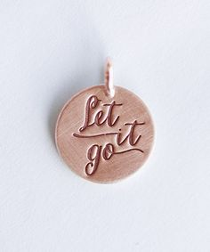 'Let It Go' Charm by Five Little Birds: How fun for a Frozen lover for the holidays!