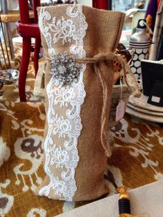 Lace and burlap with rhinestone broach wine bag