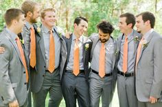 Gray groomsmen suits. The groom is differentiated by the darker gray compared to the lighter gray.