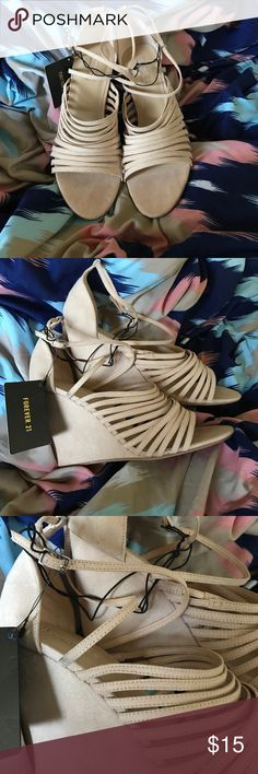 Tan Faux Suede Strapped  Wedge Heels. Never Worn. Tan faux suede wedge heels. Never worn. Super cute. Forever 21 brand. Wedge heel is about 4 in tall. Tags still attached. Forever 21 Shoes Heels