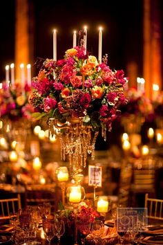 large group of flowers around candle sticks