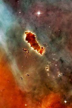 Globules of metallic supernova ash in the Eta Carinae Nebula