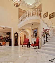 Welcome: A sleek white marble floor lines the entryway, which features a gold chandelier h... http://dailym.ai/P61LtJ#i-aa040e72
