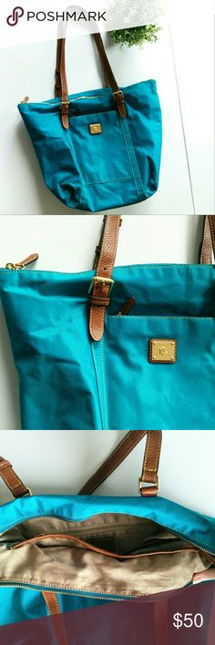 Ralph Lauren Duffield Tote Bag Make an offer! Large teal blue vinyl Ralph Lauren tote bag. Minor signs of wear in the texture of the bag if you gloss it in the light just right because it's vinyl, one ink scuff on exterior. Great chipper Spring/Summer Bag. Ralph Lauren Bags