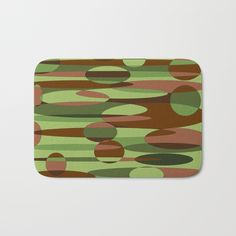 Trendy green and brown camouflage spheres bathmat with matching shower curtain