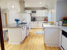 I have a thing against white cabinets, but I like the floorplan and I think it would work with our space.