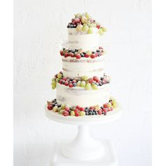 """Sweet bloom cakes. """"Semi-frosted naked cake adorned with fresh fruit for a modern, rustic wedding """""""