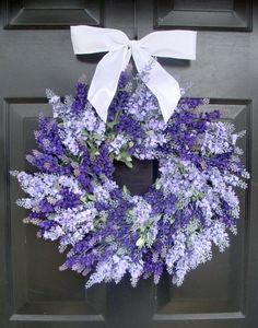 Lavender Wreath, Summer Wreath, Outdoor Wreath for Door, Floral Wall Decor, Door Decor    Beautiful shades of dark and light purple silk lavender are used to create this stunning silk lavender wreath! Unlike dried lavender, this lavender wreath can be displayed outdoors or indoors! Created without the use of hot glue, this wreath will be able to with stand the hot summer heat even doing well in between a storm door. Hung with a beautiful white satin bow, although other colors are available…
