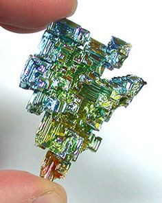 Bismuth is extremely rare ocurring as crystals in nature. Our crystals are laboratory grown, and exhibit beautiful colors and formations. Scarce as silver, heavier than lead, one cubic foot of Bismuth would weigh over 600 pounds. It is classified as a semi-precious semi-metal. Chemical Composition: Bi  Hardness: 2 - 2.5 Metaphysical Properties: transformation, progression and order. Corresponding Astrological Sign: Aquarius