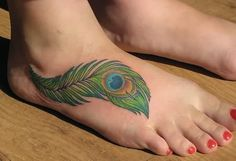 Feather Tattoo Designs: Leg tattoos peacock feathers for women