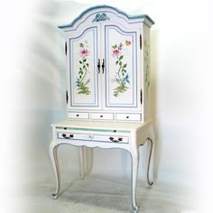 Wildflower Garden Hand-Painted Secretary.  Wallpapered interior, pull-out writing surface, images include butterfly, frog and snail. 78 inches high, 34-1/2 inches wide, 19 inches deep.