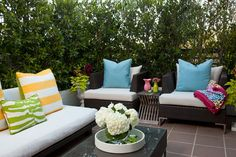I wish I had an outdoor space large enough to include this furniture and colorful pillows.