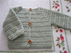 Crocheted baby sweater.........sage green cardigan