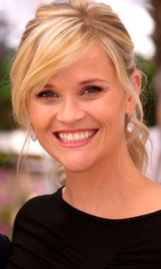 Reese Witherspoon Gave Her Updo A Relaxed Feel With A Sweeping Fringe, 2012