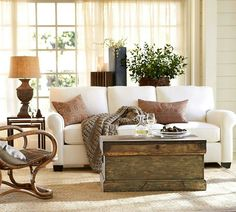 Lounge room- Buy wool throw and old chest burlap and gold and green accents