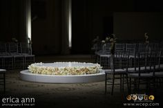 Wedding Design and Rentals by West Coast Event Productions:   Beautiful two-tiered Ceremony Platform in Gloss White with Silver Chivari Chairs.     Photography by Erica Anna Photography.     Floral by Geranium Lake.   http://www.wcep.com #westcoasteventproductions