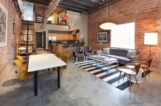 Exposed steel pipes and brick walls usher in the industrial style