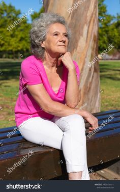 Pensive serene old lady relaxing in park. Senior grey haired woman in casual sitting on bench, leaning head on hand and looking into distance. Leisure in park concept , Hand On Head, Sitting Cross Legged, Old Women, Serenity, Distance, White Jeans, Photo Editing, Royalty Free Stock Photos, Artsy