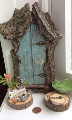 Enchanting Fairy Door by Olive ~ Indoor/ Outdoor ~ Wire on Back for Easy Placement ~ Scaled to work with most fairies! , Swarovski Crystal Door Knob. Each Hand Cut ~ Each One of A Kind! ~ Includes Tiny Key~ This listing is for Fairy Door Only* This design is fixed hinge and does
