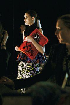 Statement clutch with eccentric prints at Kenzo AW14 PFW. More images at: http://www.dazeddigital.com/fashionweek/womenswear/aw14
