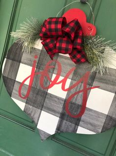 Plaid Door Hanger – Joy Christmas sign This fancy ornament shaped Christmas door hanger features a chunky buffalo check pattern … Christmas Tree Pattern, Wooden Christmas Trees, Christmas Signs, Rustic Christmas, Christmas Projects, Holiday Crafts, Christmas Holidays, Christmas Wreaths, Christmas Decorations
