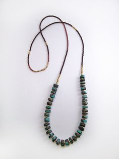 Turquoise of the Earth - Brass, Seed Bead and Heishi Turquoise stone Long Necklace. $77.00, via Etsy.