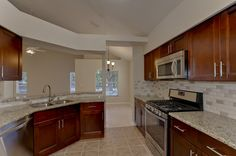 1443 Scotch Pine Spacious kitchen boasts NEW soft-close wood cabinets, NEW granite counters & breakfast bar, NEW Stainless steel appliances, complete with 5 burner gas range for the discerning chefs in the family!
