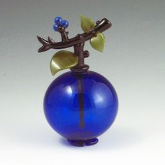 """""""Blueberry Perfume"""" Blueberry scent bottle is carefully crafted by hand from cobalt blue glass and individually mouth-blown and sculpted at the torch. These tiny treasures are fun, functional and collectible. Signed and dated on bottom."""
