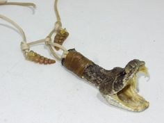 Mountain man necklace....v673....Rattlesnake head pendent with two rattlesnake rattles......replica primitive...........