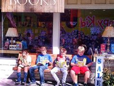 Outside Rakestraw Books, with the big bus reflected. #HardLuck #greatkids