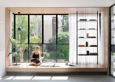 Thin black frames draw the eye around a renovated Tel Aviv apartment