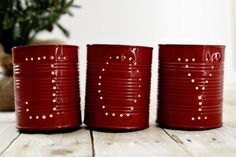 This is another recycling project that will give you pretty luminaries or candle holders this season. To make these, you will need to fill empty and clean cans with water and freeze for up to 12 hours. Once the water has turned to hard ice, you can then nail holes along the sides of the cans to spell out J-O-Y.