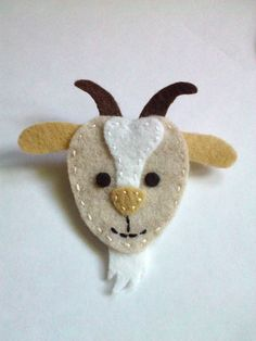 Hes baaaaa-ck! Our wooly goat pin is made with felt and measures 2 3/4 W x 2 3/4 H. Pin back has a standard silver brooch pin that will attach this