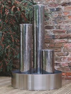 Tresa1 Three stainless steel columns with Steel Base reach for the sky in this all-inclusive and stunning water feature equipped with colour-changing LED lights includes Pebble Pool.