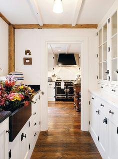 White cabinets and black hardware. Seaside Style: Nantucket Nest