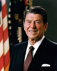 """Ronald Reagan, was the 40 president of the untied states. He was in office between 1981-1989. """"That someone came in the form of Ronald Reagan. And when Reagan went on TV and called the Shorawi 'the evil empire,' Baba went out and bought a picture of the grinning president giving the thumbs up. He frame the picture and hung it in our hallway, nailing it right next to the old black and white of himself in thin necktie shaking hands with King Zahir Shah"""" (133, Housseini)"""
