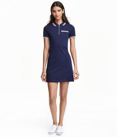 Dark blue. Short dress in cotton piqué with a collar. Zip at top, chest pocket, and short sleeves with ribbed trim. Unlined.