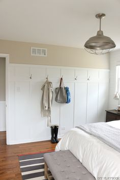 Board and batten wall with hooks in the master bedroom. This adds character and storage to this space.