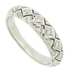 Marquis and triangular shaped cutwork all set with dazzling diamonds adorn the surface of this remarkable 14K white gold wedding band. The antique style wedding ring is photographed with its matching engagement ring R3455 (sold separately). The band measures 4.42 mm in width. Size 5 1/2. We can re-size slightly.