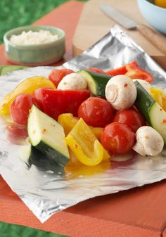 Sensational Foil-Pack Vegetables — Scootch over the burgers and make room for this flavorful, grilled side-dish recipe. Ripe veggies steam in their own juices and zesty dressing in a no-mess foil pack.