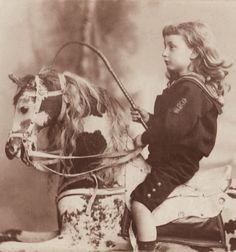 +~+~ Antique Photograph ~+~+  Amazing portrait of a young boy with long hair sitting on a beautiful toy horse.