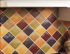 Check out how to paint a faux tile backsplash! Get exactly the colors YOU want AND save money!