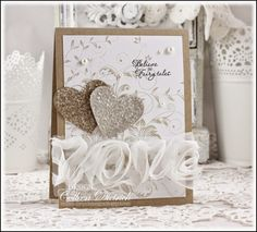 Believe In Fairytales - Dietrich Designs.  A kraft and white wedding card (or bridal shower) using Leafy Vine from Hero Arts, sentiment from Verve, white rosette trim from American Crafts, and glittered heart punches.
