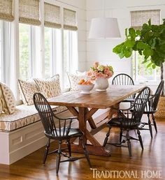 Pretty banquet style seating with farmhouse table. I want a window seat in the dinning area. Farmhouse Dining Room Table, Rustic Table, Dining Rooms, Dining Area, Sunroom Dining, Rustic Wood, Built In Dining Room Seating, Rustic Sunroom, Outdoor Dining