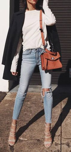 what to wear with a black coat : white top + bag + rips + heels