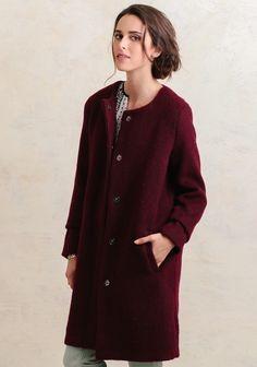 Crafted in a stunning burgundy hue, this classic wool-blend coat features a collarless neckline and shift-style silhouette with hidden snap-button closures down the front. Perfected with side p...