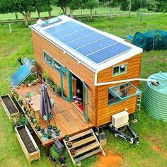 Eco Tiny House Off-Grid Living! Solar power, rainwater collection, biogas, container gardens, patio living space & a skylight to top it all… Buy A Tiny House, Off Grid Tiny House, Tiny House Living, Tiny House On Wheels, Home Design, Tiny House Design, Best Solar Panels, Solar House, Sustainable Living